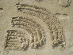 RSS-Icon im Sand